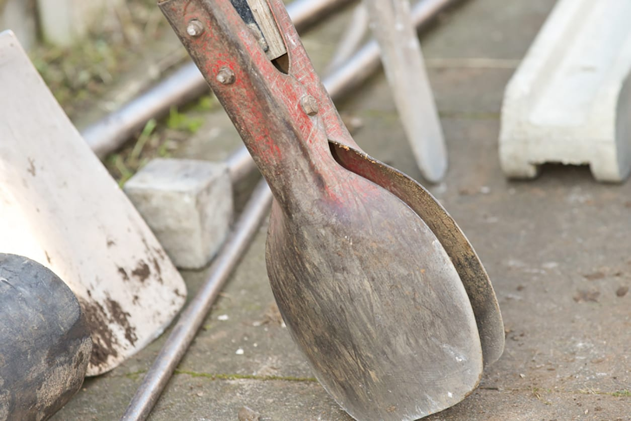Posthole digger used for digging holes for fencing posts